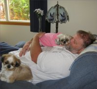 Ling Ling and Tilly snuggling with Daddy.  Note where LL has placed her little butt.  Photo credit: Sandra Bell Kirchman